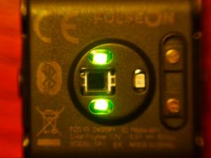 the underside of the watch showing the two green LEDs and the third additional LED for better accuracy.